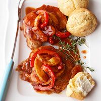 Fruited Pork Chops Recipe - Slow cooker recipes don't get any easier than this! With just six ingredients and 15 minutes of prep time, this fruit-topped pork chop dish will become a new weeknight favorite.