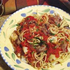Sausage, fennel, onion and tomatoes make for a robust pasta topping.