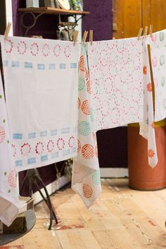 Stamped tea towels with everyday home objects ... how about using corks and wine bottles (the bottoms would make an interesting pattern)