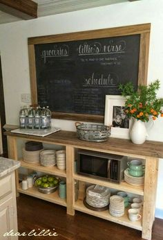 This would also be cool. You could paint chalk board on a piece of plywood and then frame it out and hang it above the hutch.