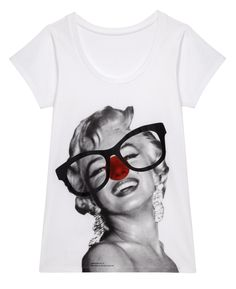 A white T-shirt with a black and white photograph of the infamous Marilyn Monroe, taken by Sam Shaw, with the addition of a red nose and glasses.  Designed by Stella McCartney exclusively for Red Nose Day.    With at least £8 going to Comic Relief, helping to change lives across the UK and Africa, t-shirt £14.99. 100% organic Fairtrade certified cotton. Wash at 40