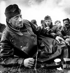 Robert Capa  June, 1944  Calvados St Laurent-sur-Mer German soldiers captured by American forces.