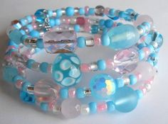 Pink and Teal Lampwork Glass Bracelet on Silver Oval Memory Wire by VineDesignBeads