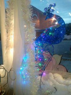 previous pinner:  Peacock, in the window of my shop, Victorian Heart gift shop in Nebraska City, Ne. Christmas 2013, Paula Haire.