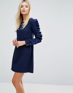 Buy it now. Closet Long Sleeved Shift Dress with Frill Detail - Navy. Dress by Closet, Smooth woven fabric, Round neck, Frill sleeve panels, Zip-back fastening, Regular fit - true to size, Machine wash, 100% Polyester, Our model wears a UK 8/EU 36/US 4 and is 176cm/5'9.5 tall. Designing and producing a covetable collection of day to night dresses in the heart of London, Closet transcends seasons to bring you fashion-forward pieces that will always be in style. Look to classic bodycon dresses…