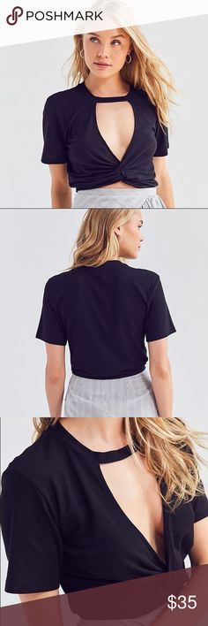 """NWT UO Cut-Out Deep-V Twist Crop Top in Black Brand new with tags. Smoke free pet friendly. Don't get it twisted in this twist-front cropped tee from Silence + Noise by UO. Made from a soft knit in a slim-cut, cropped length. Topped with a banded crew-neck + plunging cutout at the center chest. Finished with extra-long short-sleeves. Cotton.  - Model is 5'10"""" and wearing size Small - Measurements taken from size Small - Chest: 27"""" - Length: 16"""" Urban Outfitters Tops Crop Tops"""