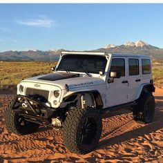 WHITE 4 DOOR JEEP LOOKING GOOD!