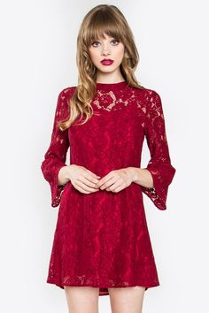 Gorgeous wine tone cocktail dress covered floral shaped lace, high neckline, and three quarter bell sleeves. Dress includes a Detachable V neck slip inset with adjustable strap and hook and eye closur