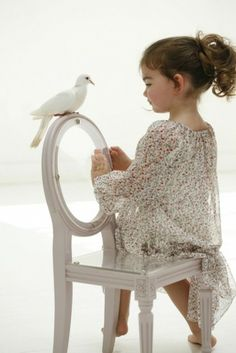Cute flower girl.. Love the chair