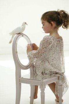 Cute flower girl.. Love the chair