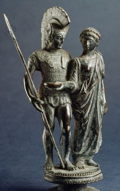 Small bronze group depicting a warrior departing for war, and his wife offering him a libation phiale, from Marzabotto (Bologna). Etruscan civilisation, 4th century BC. Marzabotto, Museo Nazionale Etrusco Pompeo Aria (Archaeological Museum)