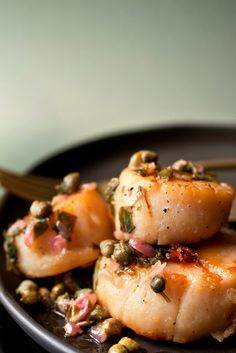 NYT Cooking: This bright yet rich treatment for scallops came to The Times in a 2009 article about Kevin Zraly, the wine director of Windows on the World from 1976 to 2001. Mr. Zraly turned the restaurant into an international wine mecca: at the time it was destroyed, when the World Trade Center fell, its cellar held close to 100,000 bottles of 1,500 labels. Mr. Zraly and Micha...