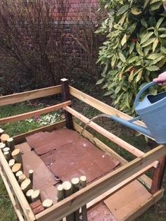 Organic Gardening 88329 Watering the vegetable garden boxes