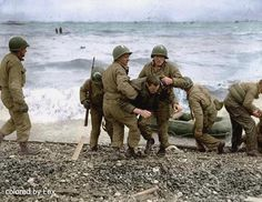 Operation Overlord Normandy Landings 7 June US troops rescue a comrade from the surf on Omaha beach, after the sinking of their landing craft. Normandy Beach, D Day Normandy, Normandy France, Bernard Montgomery, Le Jour Le Plus Long, Omaha Beach, D Day Beach, Normandy Invasion, D Day Landings