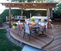 Small-Space Sanctuary -  This deck's thoughtful design offers plenty of outdoor living space without taking up too much of a small backyard. The deck is divided into areas for eating, conversing, and relaxing in the hot tub. Its curved design is an aesthetic step up from a boxy builder deck, and it effectively utilizes the limited space.