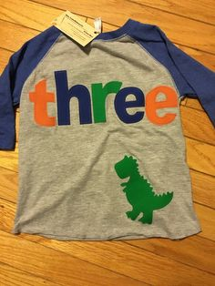 A personal favorite from my Etsy shop https://www.etsy.com/listing/266045700/three-dinosaur-t-rex-birthday-t-shirt