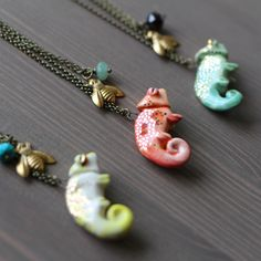 """This is a collaborative set between Small Wild and My Selvaged Life. Each set includes one glazed and gold detailed Chameleon on a 24"""" chain, and a little brass fly necklace on a 22"""" chain. Don't worry about the fly. It's the chameleon's BFF."""