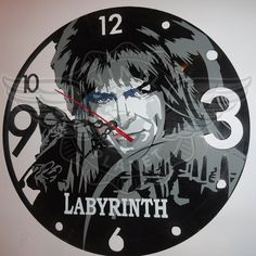 Hey, I found this really awesome Etsy listing at https://www.etsy.com/listing/260366516/vinyl-wall-clock-david-bowie-labyrinth
