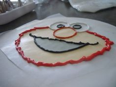 Easy DIY for homemade cake topper. Elmo example, could do any character brand with right colors!
