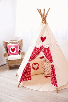 Polka dot tee pee. Great for kids room. I imagine it in blue polka dot for my son. Lovely!