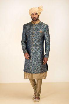 THE STYLE LOFT BY RITU DEORA Teal Green Brocade Sherwani With Golden Chudidar. #flyrobe #groom #groomwear #groomsherwani #sherwani #flyrobe #wedding #designersherwani