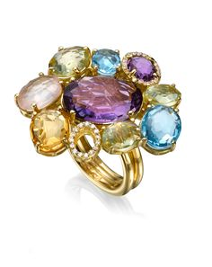 NANIS ~ An 18k yellow gold flower ring set with precious stones and diamonds