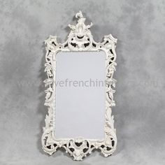 This elegant french style decorative mirror is finished in Antique White and would make a great addition to a room Also available in noir black gold