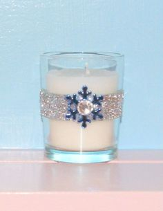 Winter Wedding Decoration  / Wedding by CarolesWeddingWhimsy, set of 6, Metallic Blue Snowflake and Silver Glitter Bling Winter Christmas Wedding Votive Candle Holder - You can find  them here https://www.etsy.com/listing/171420377/winter-wedding-decoration-wedding-votive  https://www.etsy.com/shop/CarolesWeddingWhimsy https://www.facebook.com/CarolesWeddingWhimsy