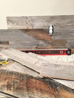 Real wood, real fast - See the basement with a feature barn wood wall!   Product is called Stikwood. Glue on the back, so easy to put up