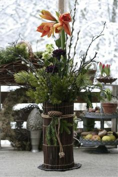 diy Winter Centerpiece- Spruce, pine, willow, mossy birch twigs and holly as buddies. Lastly, wrap a twig placemat around vase.