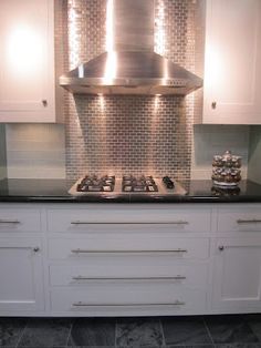 The Tile Shop: glass backsplash with stainless steel behind the stove
