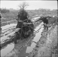 "A small boy helps a British motorcycle despatch rider negotiate a muddy road in the Netherlands 11th December 1944. [800x796] <a href=""http://ift.tt/2gTzPsl"" rel=""nofollow"" target=""_blank"">ift.tt/2gTzPsl</a>"