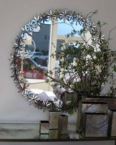 The glimmering flowers on this new mirror from Oly Studio look like a garland. Enchanting and unusual.