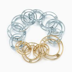 Atlas® link bracelet in 18k gold and sterling silver, medium.