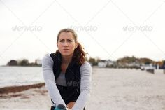 Female athlete taking a break from workout ...  active, activity, athlete, attractive, autumn, away, background, beach, beautiful, break, caucasian, copy, copypspace, endurance, exercise, exercising, female, fit, fitness, girl, health, healthy, jog, jogger, leg, looking, model, nature, ocean, one, outdoors, people, person, relaxed, relaxing, resting, run, runner, sea, shore, space, sports, sportswear, stretching, summer, training, woman, women, workout, young