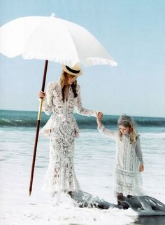 Taken from the November 2011 issue of Vogue in a spread by Patrick Demarchelier, Caroline Trentini walked in the ocean in a gorgeous Alexander McQueen ribbon-embroidered jacket and matching skirt.