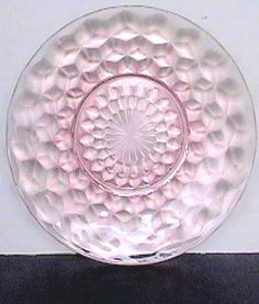 """Cube Pattern Pink: This pattern known as """"Cube"""" or """"Cubist"""" is from the Jeannette Glass Co famous for their mass production of Depression Glass. This Saucer or Sherbet Underplate was discontinued during WWII."""
