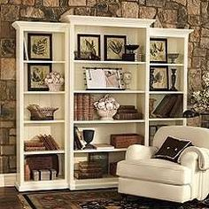 #DIY Add Crown Molding to top and bottom of bookcases to create a designer look.
