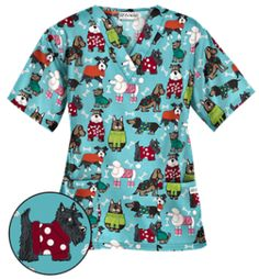 UA Best Dressed Pooch Amazing Aqua Print Scrub Top Calling all dog lovers, UA's classic V-neck scrub top offers a loose body fit with side slits for a relaxed fit through the hip. Style # PC62BAA #UniformAdvantage #UAscrubs #ADayInScrubs #BlueScrubs #PrintScrubs #DogScrubs #VetScrubs #VetTech #Scrubs