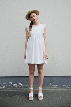 This is the ultimate Summer look - sleeveless white dress and a straw hat <3   http://www.thewhitepepper.com/collections/dresses/products/sleeveless-bib-frill-smock-dress-ivory