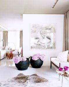Neutrals Go Glam in This Spectacular Lisbon Home// cow hide, pink hydrangeas in large urns