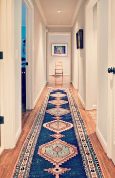 Celebrate the length a narrow hallway gives you! Create room with a long, exotic runner! #CarrellRogers #CarpetOne