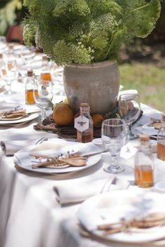 Heavenly summer gathering - fresh honey bottles at the place settings and green queen annes lace flowers. A lovely table set up.