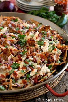 Pulled Chicken Chilaquiles - A fantastic dish made with corn tortillas, pulled chicken, and melted cheese. Perfect for Cinco de Mayo! Mexican Dishes, Mexican Food Recipes, Mexican Meals, Mexican Cooking, Mexican Chicken, Chicken Chilaquiles, Chicken Nachos, Great Recipes, Favorite Recipes