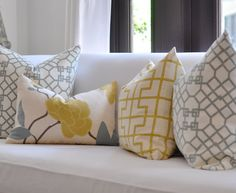 Like the pillow combination. Geometric and floral w pop of color.