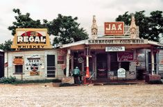 """June 1940. Melrose, Louisiana. """"A crossroads store, bar, 'juke joint' and gas station in the cotton plantation area."""""""