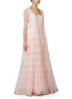 A unique and stylish combination of a long dress and a lightly embroidered jacket. Perfect as a set or as separates. Anita Dongre is one of the most versatile designers of the Indian Fashion Industry. Her collections combine the best of modern styling and Indian embroidery and detailing. She creates beautiful Dresses, Kurtis, Tops, Tunics and Salwar Kameez Suits.
