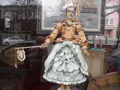 doll in store window