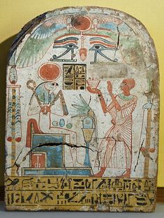 Upper tier: the priest Padiuiset burning incense in honor of Ra-Horakhty-Atum; Lower tier: offering formula to Osiris. Coated and painted wood, ca. 900 BC (22nd Dynasty).