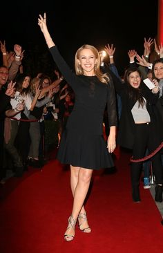 "It feels good to be home. Kylie Minogue offers peace to her hometown fans on the red carpet for ""The Voice Australia"" at Fox Studios on June 20, 2014 in Sydney Australia."